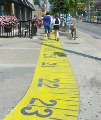 Measuring_tape_sidewalk_harris